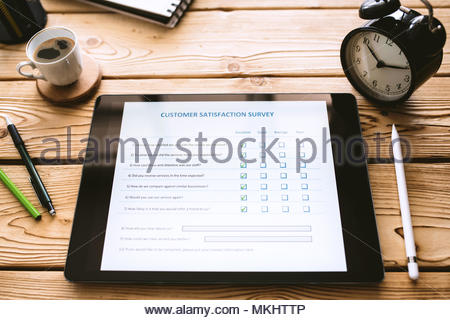 Customer Satisfaction Electronic Survey Concept on Digital Tablet Screen - Stock Photo