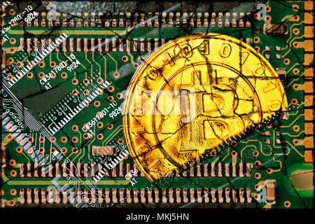 Coin with bitcoin characters and computer circuit board with cracks, loss in value of the crypto-Currency Bitcoin, Münze mit Bitcoin-Zeichen und Compu - Stock Photo