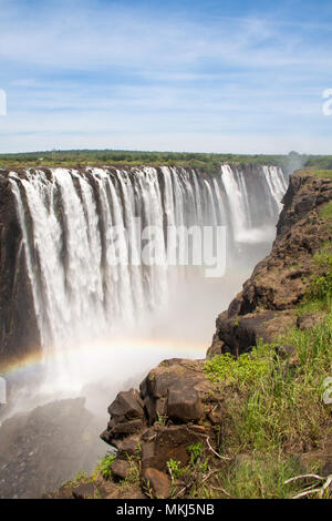 Victoria Falls with Rainbow, Zimbabwe - Stock Photo