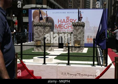 New York City, New York, USA. 8th May, 2018. In honor of Cable Network Lifetime's upcoming film, ''Harry and Meghan: A Royal Romance, '' and the latest royal nuptials, a mini Royal Court of dressed up corgis was featured as members of the Royal Family, as they walked a regal red carpet and played in front of a Windsor Castle replica outside of Macy's Department store in Herald Square, New York on 8th. May, 2018. Credit: G. Ronald Lopez/ZUMA Wire/Alamy Live News - Stock Photo
