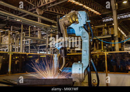 Industrial robot is test run new program in car factory - Stock Photo