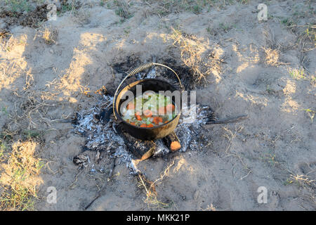 Vegetable stew being cooked in a camp oven while bush camping, Far North Queensland, FNQ, QLD, Australia - Stock Photo