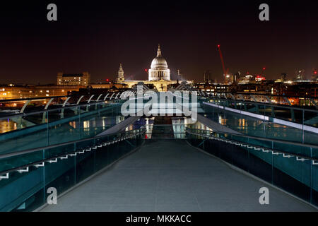 Saint Pauls Cathedral and The Millennium Bridge, London, at night - Stock Photo