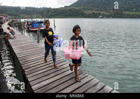 Ao Yai in Koh Kood island, Thailand - 28 January 2018:  girls walking on the pier at Ao Yai in Koh Kood island on Thailand - Stock Photo