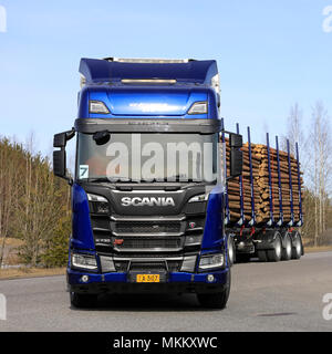 Blue Scania R730 XT logging truck up front on test drive during Scania Tour Turku 2018 in Lieto, Finland - April 12, 2018. - Stock Photo