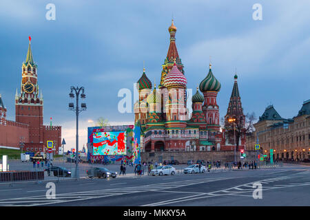 MOSCOW, RUSSIA - APRIL 30, 2018: View of the Red Square, St. Basil's Cathedral and the Spasskaya Tower of the Moscow Kremlin from the Bolshoy Moskvore - Stock Photo