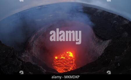 View inside the Kilauea volcano summit lava lake showing a significant drop in volume as the volcanic eruption continues destroying homes, forcing evacuations and spewing lava and poison gas  May 6, 2018 in Leilani Estates, Hawaii. - Stock Photo