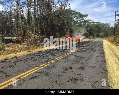 U.S. Geologic Survey scientists monitor the Kilauea volcanic eruption along Leilani Avenue May 6, 2018 in Leilani Estates, Hawaii. The recent eruption continues destroying homes, forcing evacuations and spewing lava and poison gas on the Big Island of Hawaii. - Stock Photo