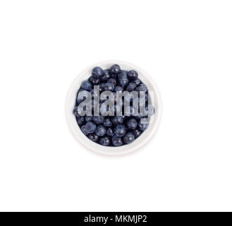 Bilberries in a wooden boin a white ceramic bowl. Top view. Ripe and tasty blueberries isolated on white background. - Stock Photo