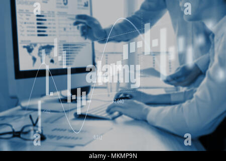 Abstract finance concept with people discussing financial data on a business analytics dashboard on computer screen in background and stock market inv - Stock Photo