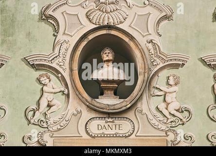Vintage sculpture portrait of Dante Alighieri on a facade of an old building in Bellinzona, Switzerland - Stock Photo
