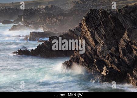 Waves crashing on the rocky coastline of Achill Island a destination on the Wild Atlantic Way  County Mayo Ireland - Stock Photo