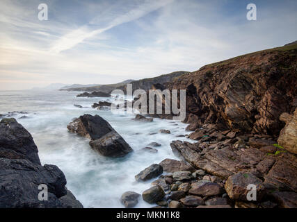 Coastline of Achill Island a destination in County Mayo with dramatic skies and waves breaking. - Stock Photo