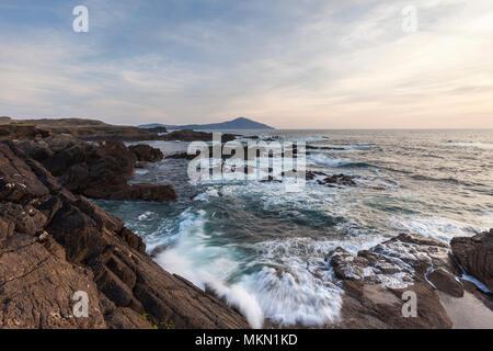 Waves breaking on the coastline of Achill Island County Mayo, overlooking Clare Island. - Stock Photo