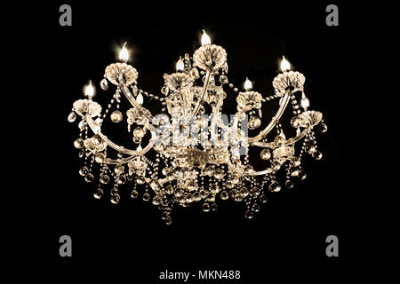 Crystal lamp.Glass chandelier isolated over black background.Closed up - Stock Photo