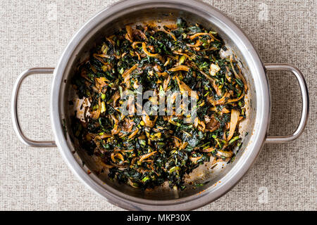 Roasted Spinach in pan. restaurant cooking concept. - Stock Photo