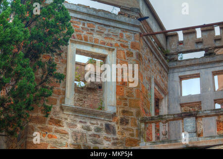 Wall and window gap of the facade of the abandoned old mansion called Dacha Kvitko in overcast day, Sochi, Russia - Stock Photo