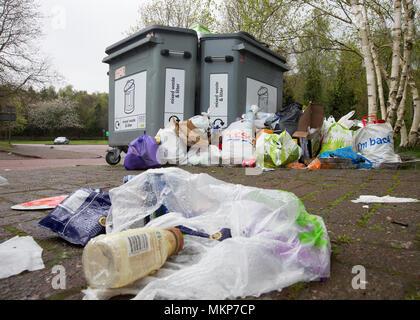 Overflowing litter bins - Stock Photo