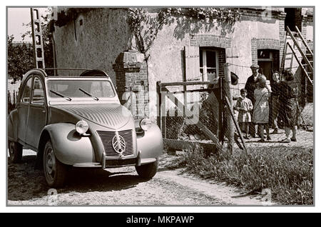 VINTAGE FRENCH AUTOMOBILE 1950's Citroën 2CV deux chevaux 1959 typical notable family French car in French rural surroundings for French press advertising - Stock Photo