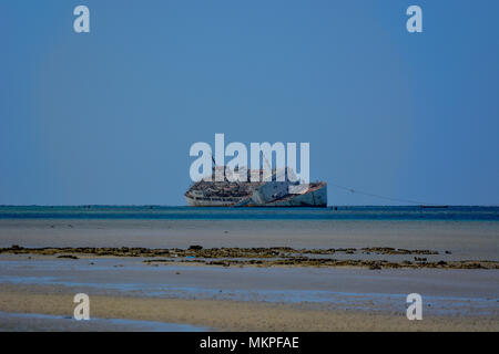 Derelict ship on the shoals of the Saudi Arabian coast of the Red Sea. - Stock Photo