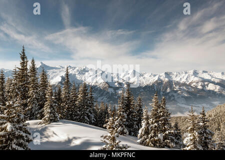 Winter View of The Central Eastern Austrian Alps Seen From The Ski Slopes of Zell Am See in Austria - Stock Photo