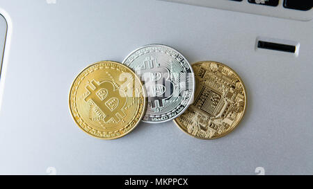 Golden and silver bitcoin coins on a laptop. Digital crypto currency. Virtual money. Metal coins of bitcoin. Bussiness, commercial, Exchange. - Stock Photo