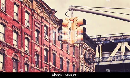 Retro toned picture of New York City traffic lights, selective focus, USA. - Stock Photo