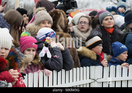TIRASPOL, MOLDOVA - FEBRUARY 18, 2018: Citizens and tourists at the celebration of the slavonic pagan holiday Maslenitsa. Maslenitsa (Shrovetide) - a  - Stock Photo