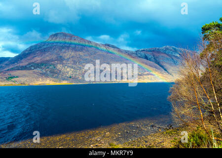 Loch Maree with Rainbow - a beautiful poster or print for your home or office to remind you of happy times in Scotland. The mountain is Casteal Mor. - Stock Photo