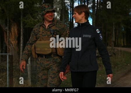 The President of Estonia Kersti Kaljulaid discusses Exercise Hedgehog with Marine Rotational Force-Europe (MRFE) 18.1 Bravo Company Commander Capt. Andrew Davis at Voru, Estonia, May 5, 2018, May 5, 2018. President Kaljulaid visited Marines and Sailors with MRFE and spoke about the importance of Hedgehog, which is an annual event designed to strengthen strategic cooperation and partnership among participants. This the first time the Marine Corps has participated in the exercise. Several NATO countries also attended Hedgehog this year. (U.S. Marine Corps photo by Gunnery Sgt. Clinton Firstbrook - Stock Photo