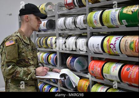 U.S. Army Spc, May 2, 2018. Dimitri Shumilov, a paratrooper with Fury Battery, 4th Battalion, 319th Airborne Field Artillery Regiment, 173rd Airborne Brigade, conducts an inventory in a supply depot at the Tower Barracks Dining Facility, Grafenwoehr, Germany, May 2, 2018. (U.S. Army photo by Gertrud Zach). () - Stock Photo