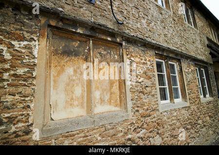 windows blocked up to avoid the window tax where the phrase daylight robbery comes from Lacock village wiltshire england uk - Stock Photo