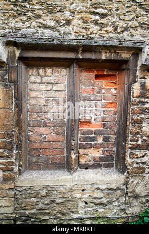 windows bricked up to avoid the window tax where the phrase daylight robbery comes from Lacock village wiltshire england uk - Stock Photo