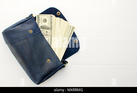 money in bag on white background. - Stock Photo