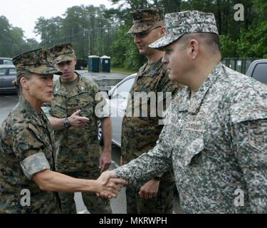 Brigadier Gen. Helen S. Pratt, the 4th Marine Logistics Group commander, greets Colombian Lt. Col. Erick Del Rio, the deputy commander of Special Purpose Marine Air-Ground Task Force - Southern Command, during her visit to Camp Lejeune, North Carolina, May 6, 2018, May 6, 2018. The SPMAGTF is preparing to deploy to Central and South America in June to conduct tailored training and engineering projects alongside security forces in these regions, and will be on standby to provide humanitarian assistance and disaster relief in the event of an emergency. (U.S. Marine Corps photo by Staff Sgt. Fran - Stock Photo
