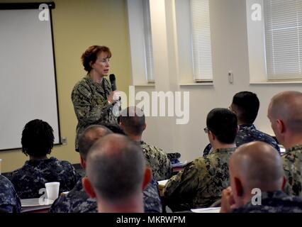 Norfolk, Va. (May 7, 2018) Rear Admiral Mary Riggs, Director, Research and Development, Defense Health Agency speaks at Expeditionary Combat Readiness Centers (ECRC) to members of Expeditionary Medical Unit (EMU) 5 prior to their deployment, May 7, 2018. ECRC provides processing, equipping, training, certification and proactive family support to ADSW Sailors, Individual Augmentees and provisional units throughout all deployment phases in support of combatant commanders requirements, contingency operations, or national crises. (U.S. Navy photo by Chief Mass Communication Specialist James C. Bro - Stock Photo