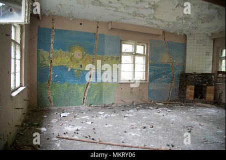 Ruined house in the former Nazi German military base, used from 1957 to 1993 by Soviet Union as military communication garrison of Northern Group of F - Stock Photo