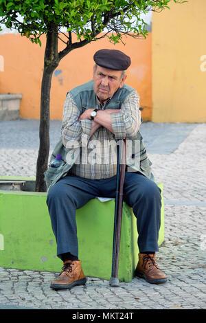 Old age and grumpy portuguese man taking a break, Beja, Alentejo, Portugal - Stock Photo