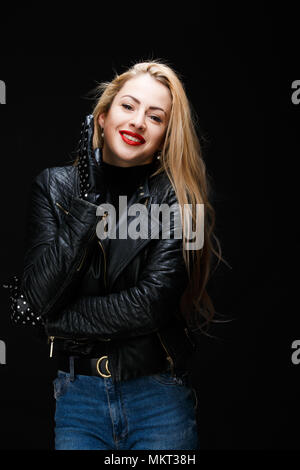 Picture of young blonde in leather jacket - Stock Photo