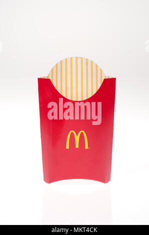 Empty Mcdonald's french fries container on white background - Stock Photo