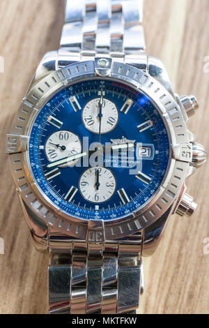 FLODA, SWEDEN – APRIL 21 2018: Close up view of high gloss stainless steel Breitling Chronomat Evolution blue watch face man's luxury watch  Model Release: No. Property Release: No. - Stock Photo