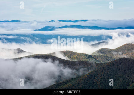 Early morning fog settles into the valleys of the mountains along the Blue Ridge Parkway in Western North Carolina on a crisp autumn October day. - Stock Photo