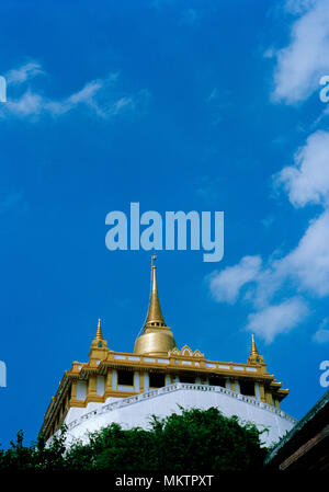 Golden Mount - Buddhist shrine of Wat Saket Ratcha Wora Maha Wihan Golden Mountain Temple in Bangkok in Thailand in Southeast Asia Far East. Sky - Stock Photo