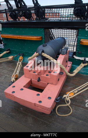 A gun on the deck of the USS Consitution (1797) at the former Charlestown Navy Yard in Boston, Massachusetts, USA - Stock Photo