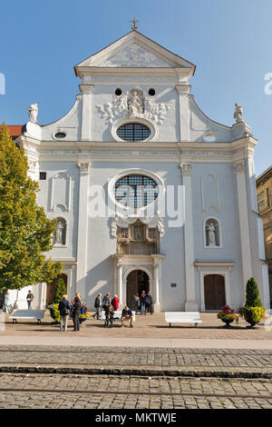 KOSICE, SLOVAKIA - OCTOBER 02, 2017: People visit Seminary St. Anthony of Padua church on Hlavna or Main street in Old Town. Kosice is the largest cit - Stock Photo