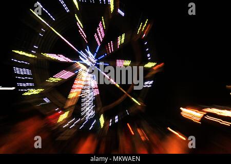 Fair wheel rotating during the night - Stock Photo