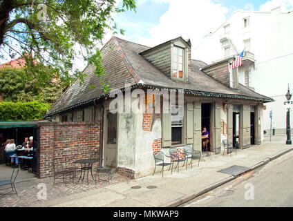 Constructed in the early 18th century, what is now Lafitte's Blacksmith Shop Bar on New Orlean's Bourbon Street is now a national hisdtoric landmark. - Stock Photo