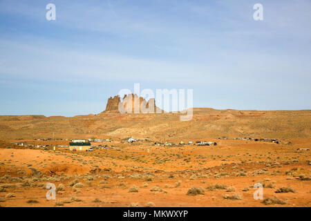 Houses, vehicles, and wrecked and used vehicles along US highway 163 in southeastern, Utah - Stock Photo