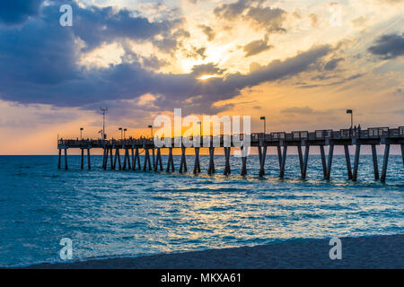 Sunset over Venice Pier on the Gulf of Mexico in Venice Florida - Stock Photo