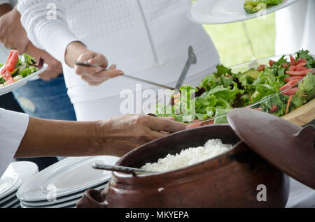 Clay pots with white and wild rice - Stock Photo